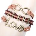 novo metal Jesus amor cristão Infinity bracelete bronze liga pulseiras trançadas de amor para as mulheres por atacado