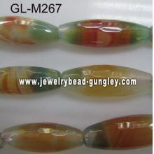 Long rice shape faceted agate bead- red green